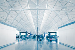 Airport with moving blur rush passenger. Shot in asia, hong kong Stock Image