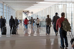 Airport moving crowd. Passengers at the modern international airport stock photos