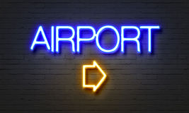 Airport neon sign on brick wall background. Stock Images