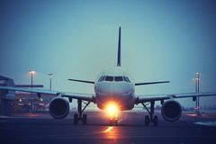 Airport at night. Airplane is taxiing to take off Royalty Free Stock Photography