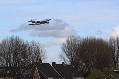 Airport noise. Big aircraft over houses near airport. Can be used to depict airport noise stock images
