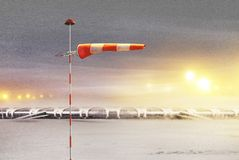 Airport at not flying night. Meteorology windsock inflated by wind in airport at not flying night stock illustration