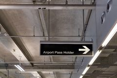Airport pass holder information board sign at international airport terminal Royalty Free Stock Images