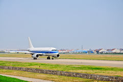 The airport passenger plane on the runway Royalty Free Stock Image