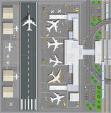 Airport passenger terminal. Top view. The runway of the aircraft. Buildings hangar for airplanes and helicopter landing pad. Railway station with train and Stock Photo