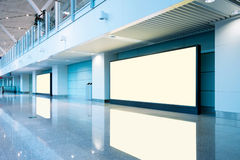 Airport passengers and blank billboard Royalty Free Stock Photo