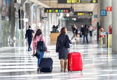 Airport passengers 053. Passengers and their belongings walk on empty airport during a major strike day in palma de mallorca´s airport in the spanish balearic Royalty Free Stock Images