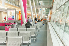 Airport passengers are waiting in terminal for their flight. Warsaw, Poland - January 13, 2015. Airport passengers are waiting in terminal for their flight ( Royalty Free Stock Photography