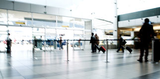Airport people moving traveling Royalty Free Stock Photos