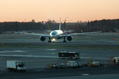 Airport, the plane on takeoff, airplanes at beautiful sunset Stock Photos
