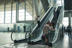 Airport Platov, Russia - 24.05.19: big family rise on the escalator at the airport. Beautiful clean escalator at the airport with lots of people stock images