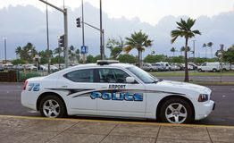 -An airport police car at the Kahului Airport. KAHULUI, HI -An airport police car patrols for safety near the terminal at the Kahului Airport (OGG) on the island stock photo