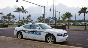-An airport police car at the Kahului Airport. KAHULUI, HI -An airport police car patrols for safety near the terminal at the Kahului Airport (OGG) on the island stock photos