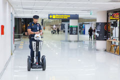 Airport Police on duty using Segway to patrol and security Royalty Free Stock Photos