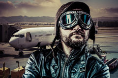 Airport, Pride pilot with black leather jacket Royalty Free Stock Photos