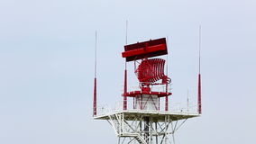 Airport radar. Rotating radar tower at an airport stock video