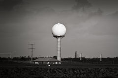 Airport radar tower in black and white. Airport dome radar tower in black and white Royalty Free Stock Images