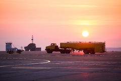 Airport refueler truck sunset. Big yellow refueler truck in the airport Royalty Free Stock Photos