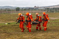 Airport Rescue #1. SEPANG, MALAYSIA - NOV 26: Malaysian rescue personnel evacuate a volunteer from a mock scene of an airplane crash-site during an emergency Royalty Free Stock Photography