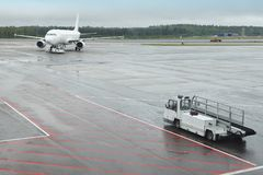 Airport runaway with airplane on a rainy day. Travel Royalty Free Stock Image