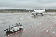 Airport runaway with airplane on a rainy day. Travel Stock Image