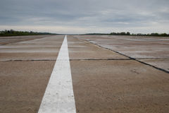 Airport runway. After rainfall. White line on runway Royalty Free Stock Photos