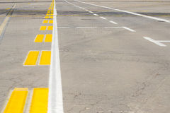 Airport runway. Airfield - marking on taxiway is heading to runway royalty free stock photo