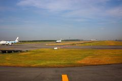 Airport runway. In the background, beautiful blue sky royalty free stock photo
