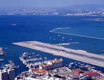 Airport runway, Gibraltar. Elevated view of airport runway with the Spanish coastline to the rear, Gibraltar, UK, Western Europe Royalty Free Stock Photo