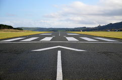 Airport Runway. Landing track of a small airport in Ireland, viewed from the beginning of the track, without planes Royalty Free Stock Photo