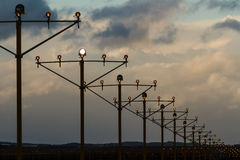 Airport runway lights at dusk. Airport aviation lights for plane approach, at dusk Stock Photos