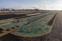 Airport Runway. Low aerial view of small airport runway and taxiway stock photo