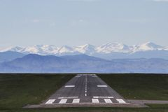 Airport runway with mountains Stock Images