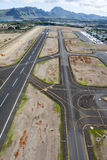 Airport runway. An airport runway from the open door of a helicopter shows the complicated layout pilots must navigate when landing Royalty Free Stock Photos