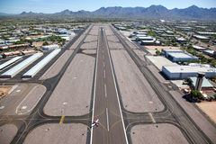Airport Runway. Runway at Scottsdale, Arizona airport looking to the northeast at the McDowell Mountains royalty free stock images