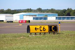 Airport runway signs hangars airfield. Landing sunny day stock photos
