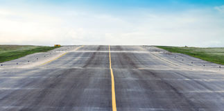 Airport runway sky is blue and the airfield Royalty Free Stock Photography