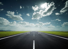 Airport runway on a sunny day. Airport runway under the sun as background Stock Photography