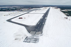 Airport Runway takeoff airplane flight travel sky clouds snow winter Siberia Stock Image