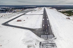 Airport Runway takeoff airplane flight travel sky clouds snow winter Siberia Royalty Free Stock Images