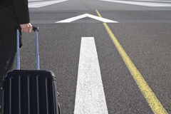 Airport runway traveller Royalty Free Stock Image