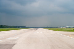 Airport runway under storm sky Royalty Free Stock Photos