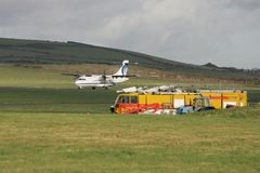 Airport safety. Fire brigade at the end of the runway Stock Photo