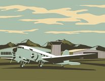 Airport Scene. Vintage looking illustration of an old plane sitting at an airport Royalty Free Stock Photography