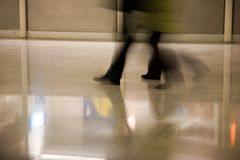 Airport scene. A shot of people's feet as they walk through an airport royalty free stock image