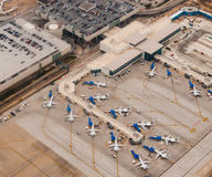 Airport scene. Ariel view of Airport scene with planes lined up at terminals , remote parking, taxiways, runways and airplanes ready to depart Royalty Free Stock Photography