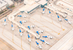 Airport scene. Ariel view of Airport scene with planes lined up at terminals , remote parking, taxiways, runways and airplanes ready to depart Royalty Free Stock Image
