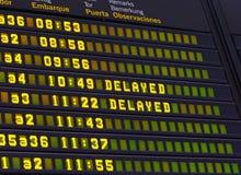 Airport schedule signboard delayed flight. Airport departures signboard showing delayed flights information stock photos