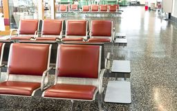 Airport Seats. Brown and steel airport seats before gating in waiting room Royalty Free Stock Photos