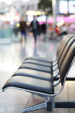 Airport seats. Black airport seats in a row Stock Images